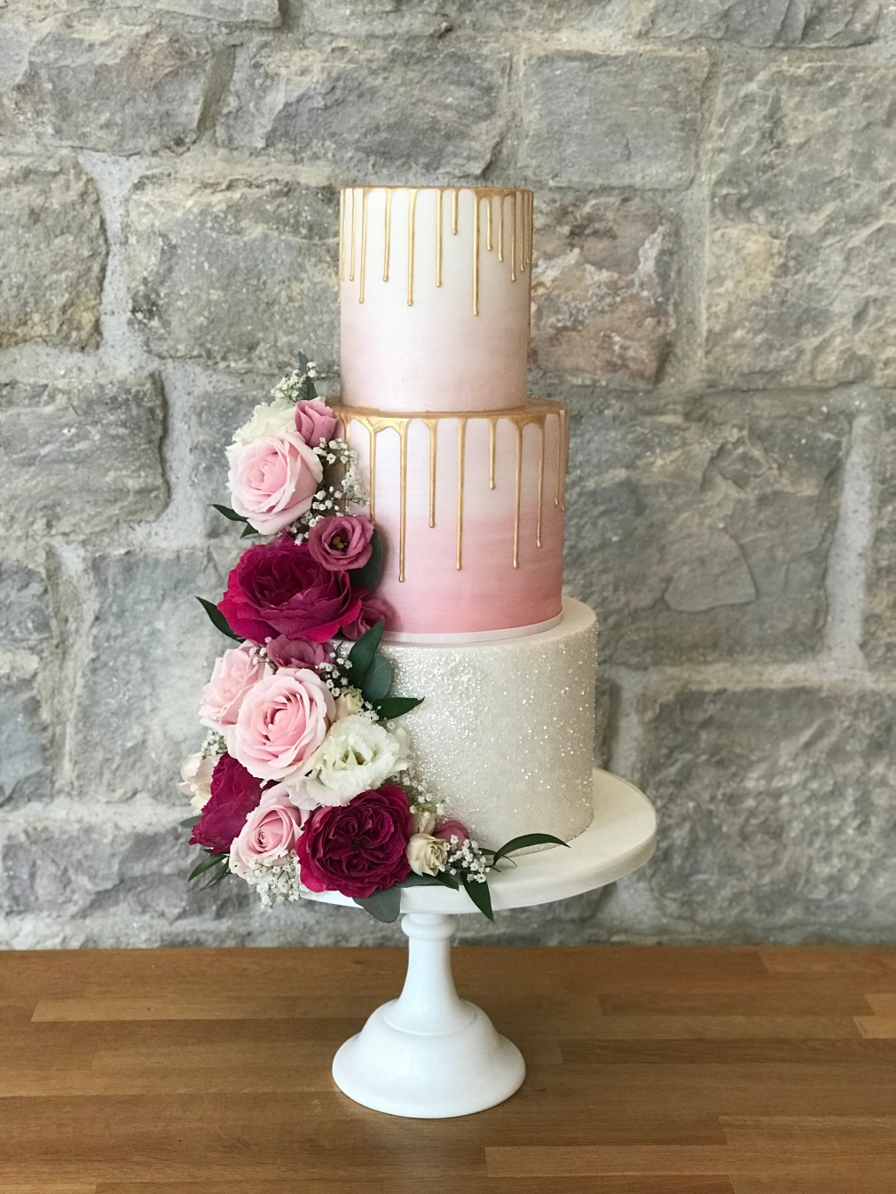 St Tewdricks Wedding Cake, Blush pink ombre with gold drips and real flowers